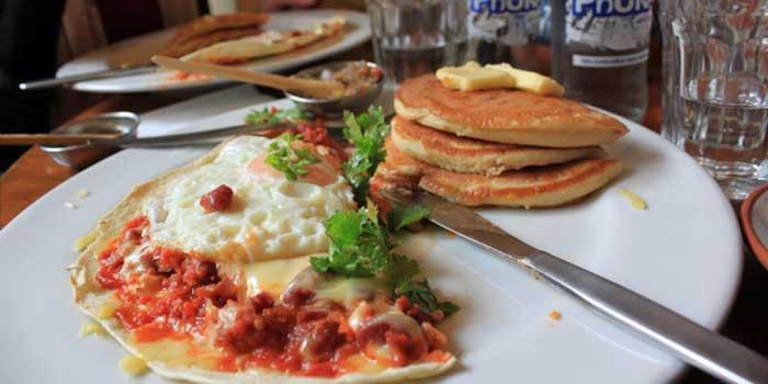 Pancakes,-chorizo,-egg,-cilantro,-cheese-on-tortilla-thing