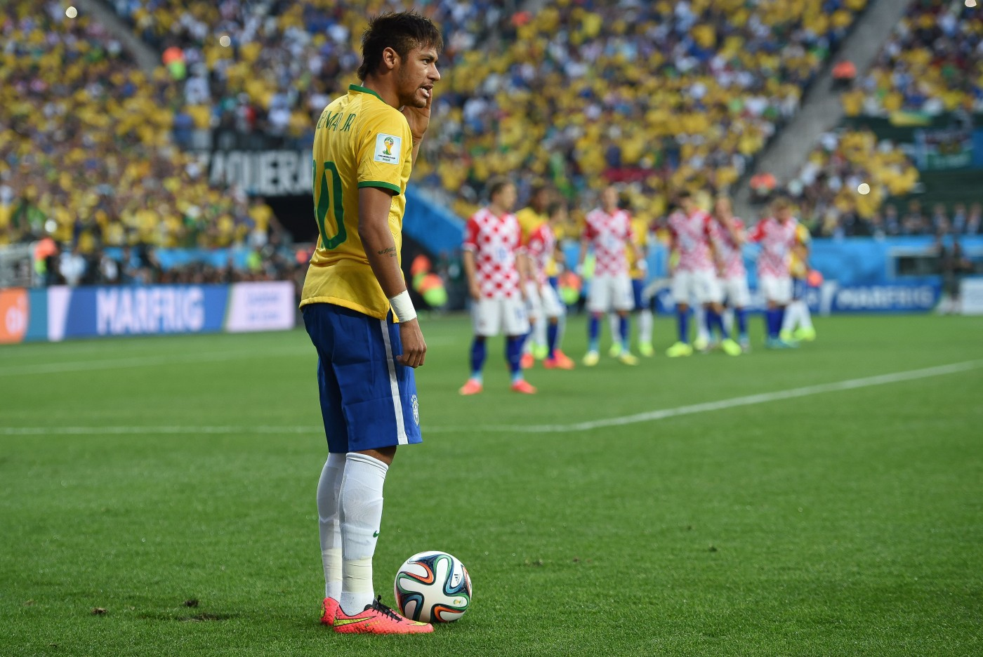 Neymar prepares to take a free kick during Brazil's opening match of the 2014 FIFA World Cup against Croatia. (Krassotkin/Wikimedia Commons)