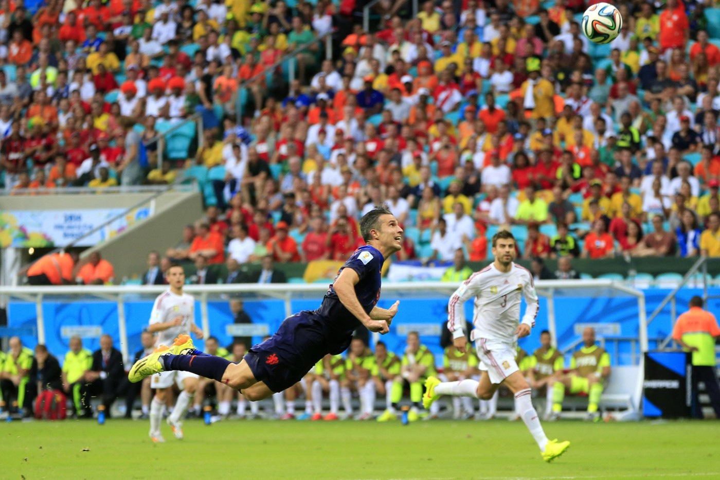 Netherlands' Robin van Persie scores a goal during the group B World Cup soccer match between Spain and the Netherlands. (AP Photo/Bernat Armangue)