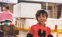 A_child_worker_in_retail,_child_labor_in_Hainan_China_December_2013