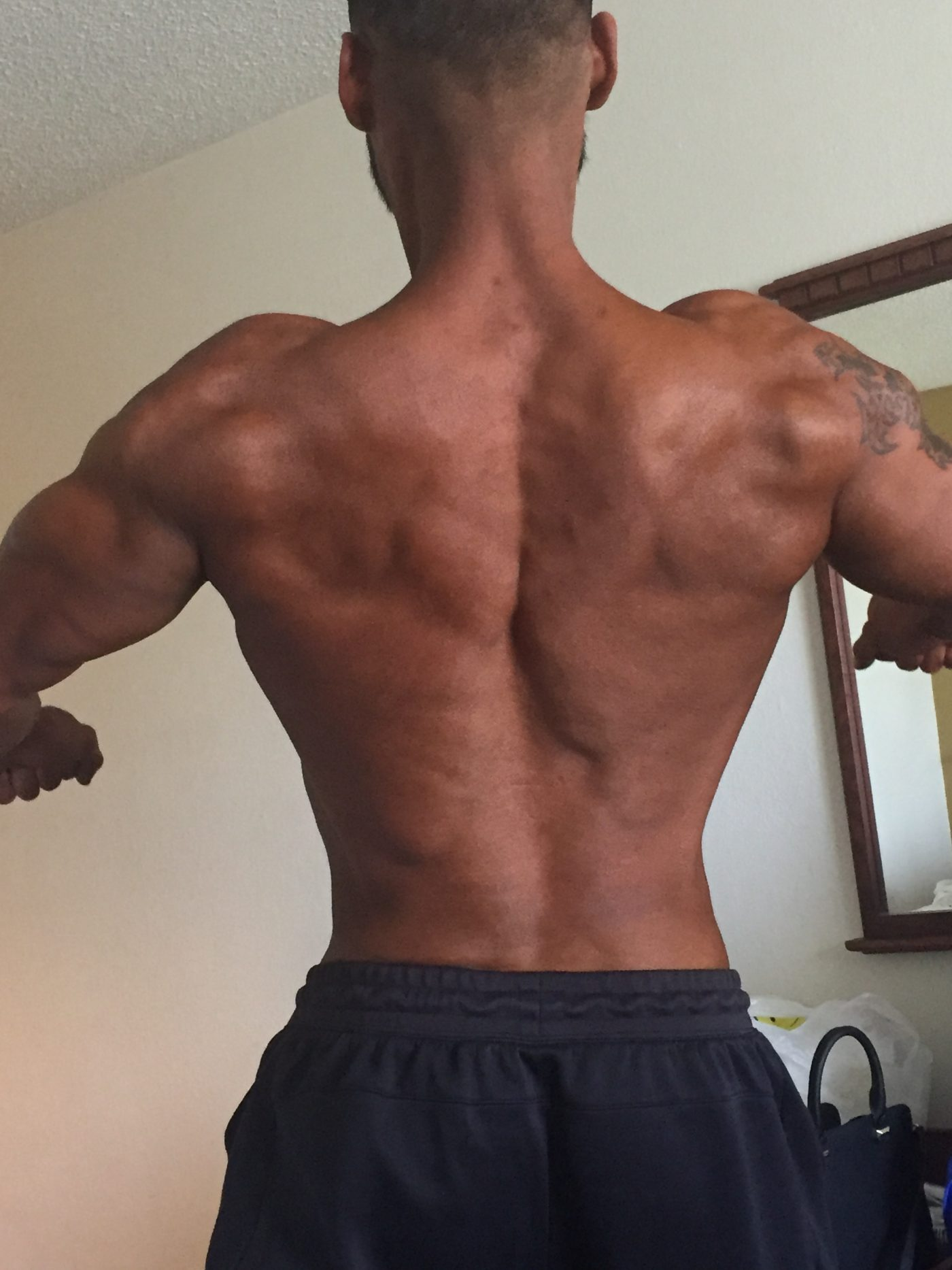 Diego showing off his back in his hotel room